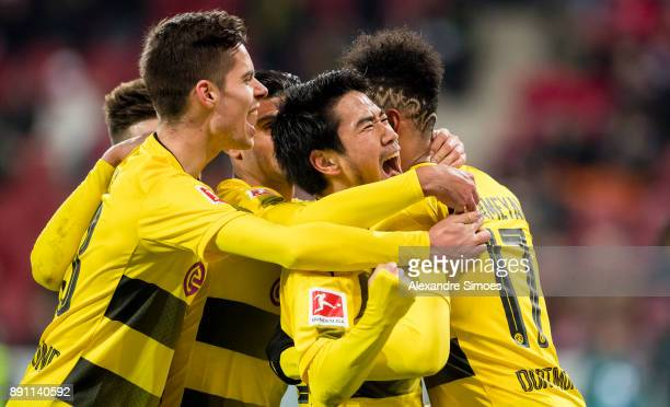 Shinji Kagawa of Borussia Dortmund celebrates scoring the goal to the 02 with his team mates during the Bundesliga match between 1 FSV Mainz and...