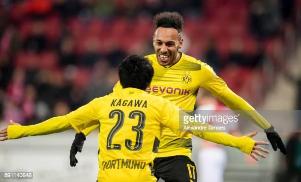 Shinji Kagawa of Borussia Dortmund celebrates scoring the goal to the 02 with PierreEmerick Aubameyang during the Bundesliga match between 1 FSV...