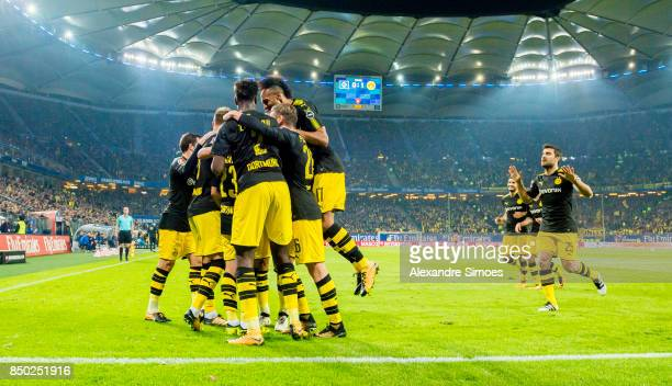 Shinji Kagawa of Borussia Dortmund celebrates scoring the opening goal together with his team mates during the Bundesliga match between Hamburger SV...