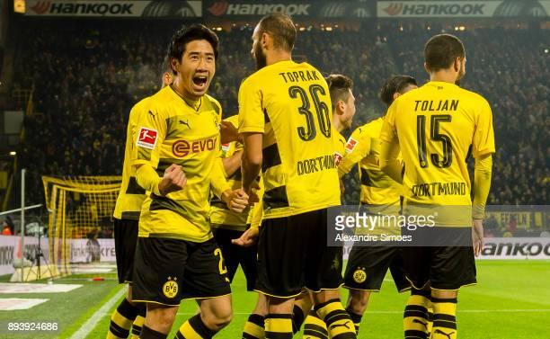 Shinji Kagawa of Borussia Dortmund celebrates the winning goal to the 21 of his team mate Christian Pulisic during the Bundesliga match between...