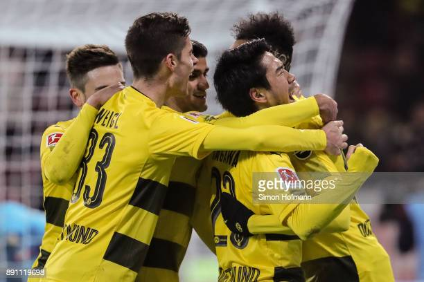 Shinji Kagawa of Borussia Dortmund celebrates with his team mates after scoring his team's second goal to make it 02 during the Bundesliga match...