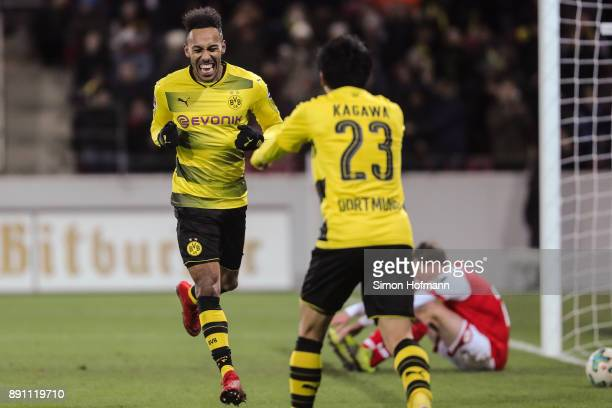 Shinji Kagawa of Borussia Dortmund celebrates with PierreEmerick Aubameyang after scoring his team's second goal to make it 02 during the Bundesliga...