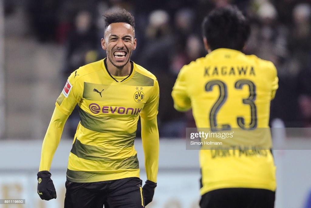 Shinji Kagawa #23 of Borussia Dortmund celebrates with Pierre-Emerick Aubameyang after scoring his team's second goal to make it 0-2 during the Bundesliga match between 1. FSV Mainz 05 and Borussia Dortmund at Opel Arena on December 12, 2017 in Mainz, Germany.