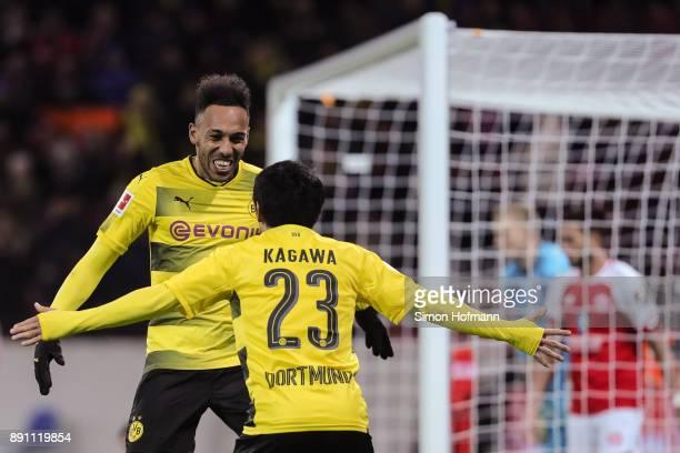 Shinji Kagawa of Borussia Dortmund celebrates with PierreEmerick Aubameyang after scoring his team's second goal to make it 02 during the Bundesliga...