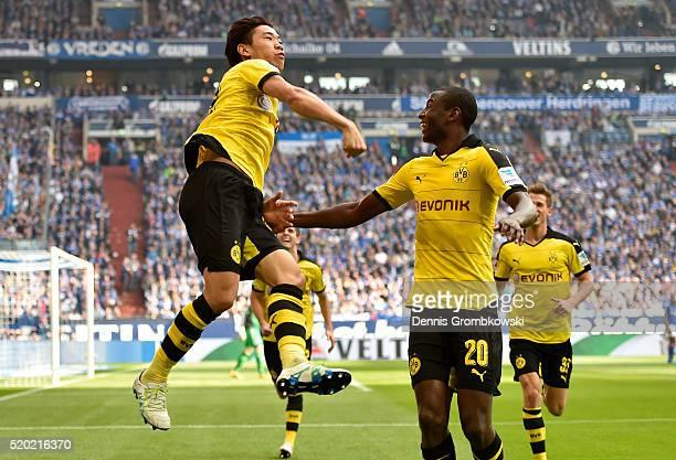 Shinji Kagawa of Borussia Dortmund celebrates with teammates after scoring the opening goal during the Bundesliga match between FC Schalke 04 and...