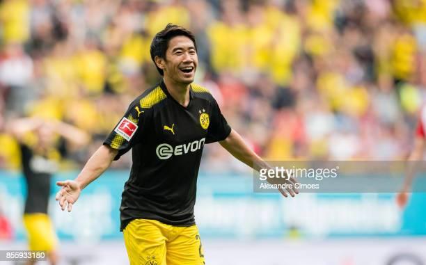 Shinji Kagawa of Borussia Dortmund cheers after scoring his team's 2nd goal during the Bundesliga match between FC Augsburg and Borussia Dortmund at...