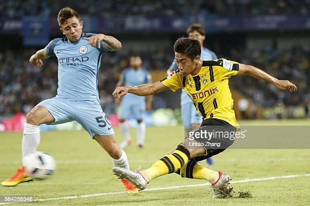 Shinji Kagawa of Borussia Dortmund contests the ball against Pablo Maffeo during the 2016 International Champions Cup match between Manchester City...