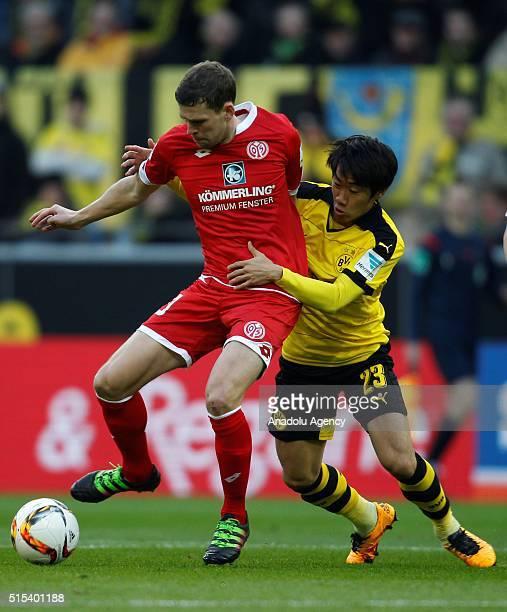 Shinji Kagawa of Borussia Dortmund in action against Fabian Frei of FSV Mainz 05 during the Bundesliga soccer match between Borussia Dortmund and FSV...