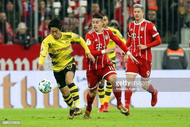 Shinji Kagawa of Borussia Dortmund in action against James Rodriguez of Bayern Munich during the German Cup soccer match between FC Bayern Munich and...