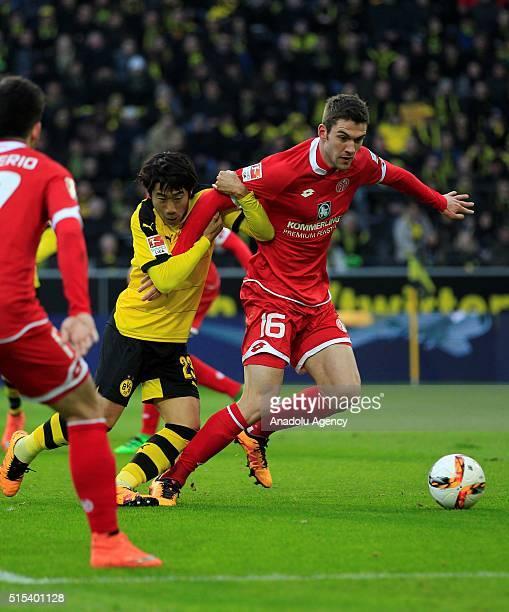 Shinji Kagawa of Borussia Dortmund in action against Stefan Bell of FSV Mainz 05 during the Bundesliga soccer match between Borussia Dortmund and FSV...