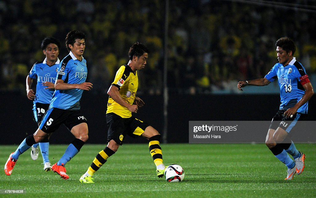 Shinji Kagawa #23 of Borussia Dortmund in action during the preseason friendly match between Kawasaki Frontale and Borussia Dortmund at Todoroki Stadium on July 7, 2015 in Kawasaki, Kanagawa, Japan.