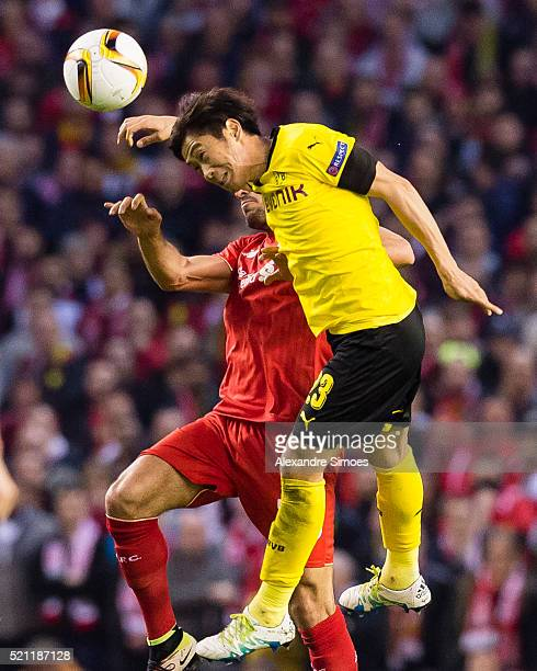 Shinji Kagawa of Borussia Dortmund in an aerial duel against Ere Can of Liverpool FC during the UEFA Europa League Quarter Final Second Leg match...