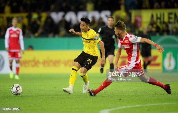 Shinji Kagawa of Borussia Dortmund is closed down as he passes the ball during the DFB Cup match between Borussia Dortmund and 1 FC Union Berlin at...
