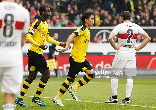 Shinji Kagawa of Borussia Dortmund is congratulated by Adrian Ramos after scoring the first goal during the Bundesliga match between VfB Stuttgart...