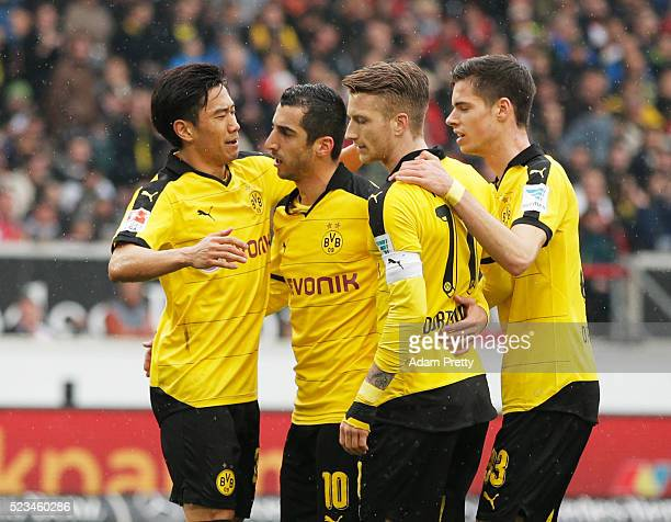 Shinji Kagawa of Borussia Dortmund is congratulated by Henrikh Mkhitaryan after scoring the first goal during the Bundesliga match between VfB...