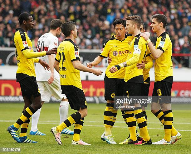 Shinji Kagawa of Borussia Dortmund is congratulated by Marco Reus after scoring the first goal during the Bundesliga match between VfB Stuttgart and...