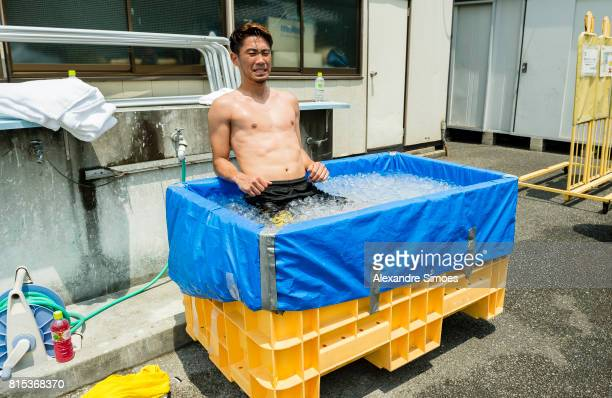 Shinji Kagawa of Borussia Dortmund is cooling down in the ice bath after a training session on July 16 2017 in Tokyo Japan