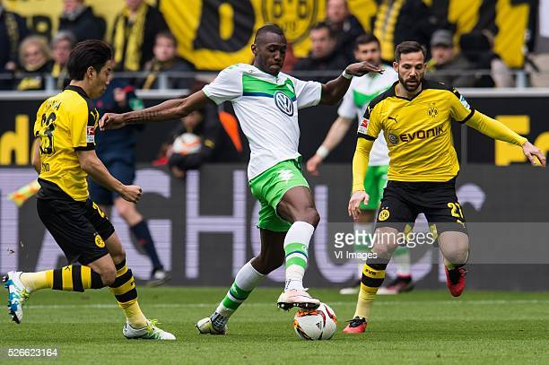 Shinji Kagawa of Borussia Dortmund Josuha Guilavogui of VFL Wolfsburg Gonzalo Castro of Borussia Dortmund during the Bundesliga match between...
