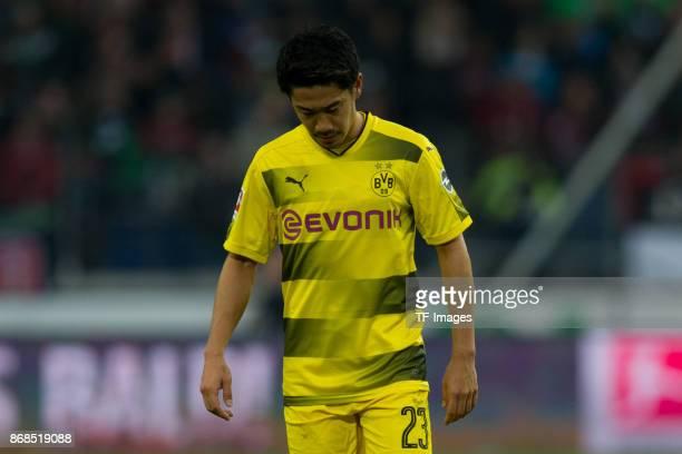 Shinji Kagawa of Borussia Dortmund looks dejected after the German Bundesliga match between Hannover 96 v Borussia Dortmund at the HDI Arena on...