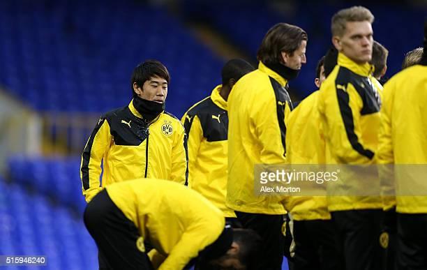 Shinji Kagawa of Borussia Dortmund looks on during a training session ahead of the UEFA Europa League round of 16 second leg match between Tottenham...