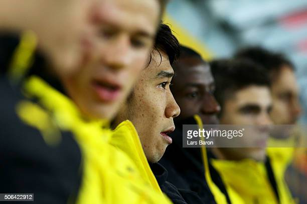 Shinji Kagawa of Borussia Dortmund looks on from the bench with team mates prior to the Bundesliga match between Borussia Moenchengladbach and...