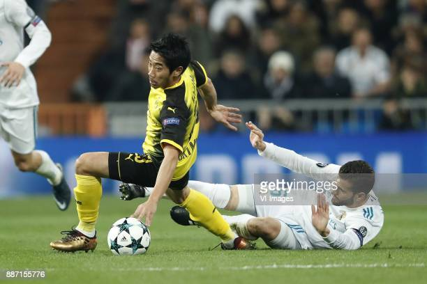 Shinji Kagawa of Borussia Dortmund Nacho of Real Madrid during the UEFA Champions League group H match between Real Madrid and Borussia Dortmund on...