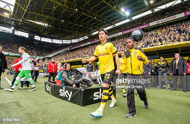 Shinji Kagawa of Borussia Dortmund on his way to the green prior to the Bundesliga match between Borussia Dortmund and VfL Wolfsburg at Signal Iduna...