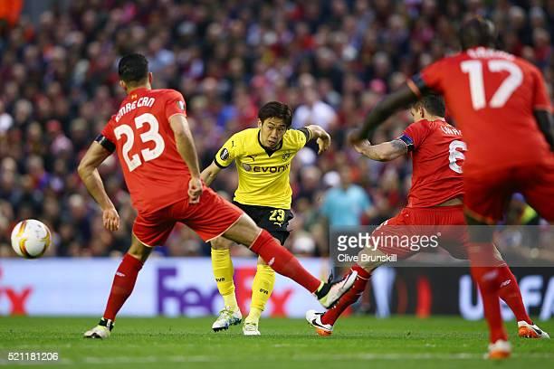 Shinji Kagawa of Borussia Dortmund passes during the UEFA Europa League quarter final second leg match between Liverpool and Borussia Dortmund at...