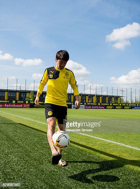 Shinji Kagawa of Borussia Dortmund poses for a portrait photo session after the training session at the training ground from Borussia Dortmund in...