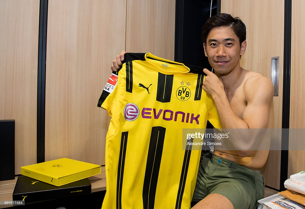 Shinji Kagawa of Borussia Dortmund revealing the new Borussia Dortmund home jersey, Season 2016-2017 on May 12, 2016 in Dortmund, Germany.