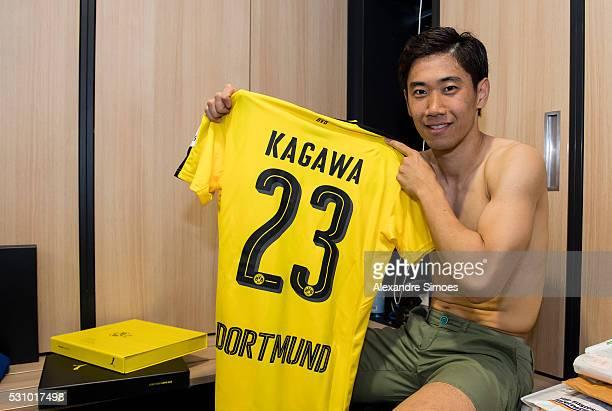 Shinji Kagawa of Borussia Dortmund revealing the new Borussia Dortmund home jersey Season 20162017 on May 12 2016 in Dortmund Germany