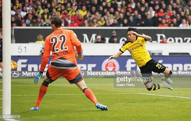 Shinji Kagawa of Borussia Dortmund scores the first goal during the Bundesliga match between VfB Stuttgart and Borussia Dortmund at MercedesBenz...
