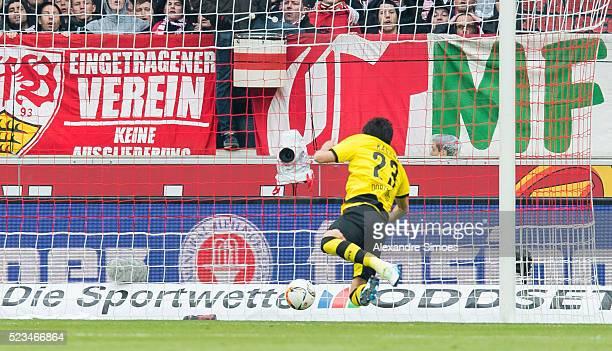 Shinji Kagawa of Borussia Dortmund scores the opening goal during the Bundesliga match between VfB Stuttgart v Borussia Dortmund at MercedesBenz...