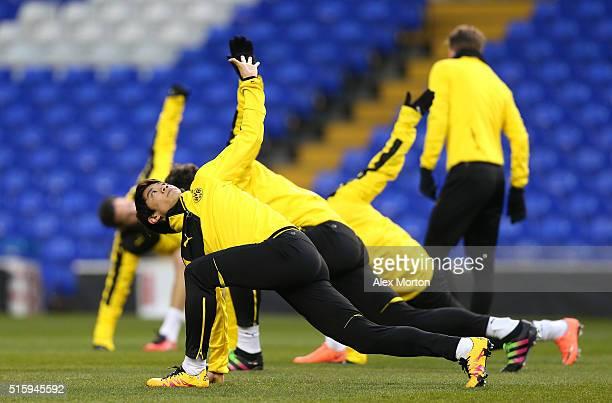 Shinji Kagawa of Borussia Dortmund stretches during a training session ahead of the UEFA Europa League round of 16 second leg match between Tottenham...