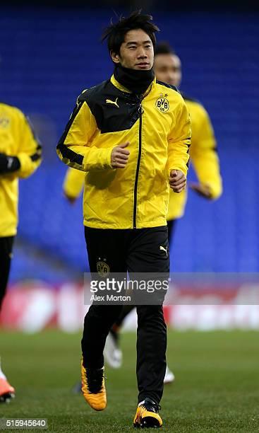 Shinji Kagawa of Borussia Dortmund warms up during a training session ahead of the UEFA Europa League round of 16 second leg match between Tottenham...