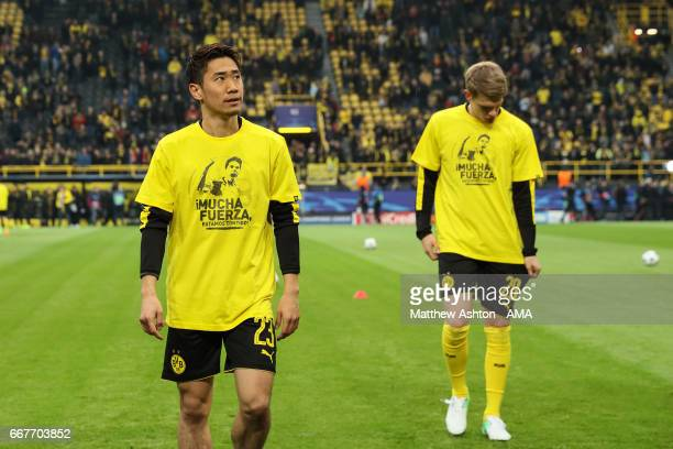 Shinji Kagawa of Borussia Dortmund wears a Tshirt showing Marc Bartra and the words 'Mucha Fuerza' which translates from Spanish into English of 'A...
