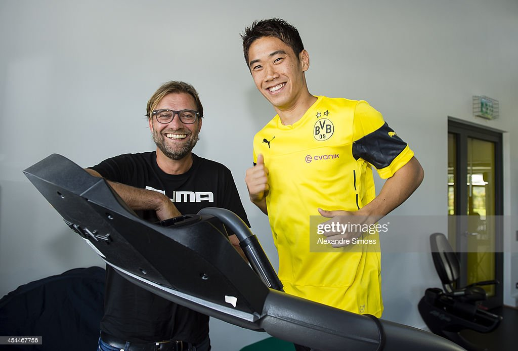 Shinji Kagawa of Borussia Dortmund with their head coach Juergen Klopp during his first training session at the club on September 01, 2014 in Dortmund, Germany.