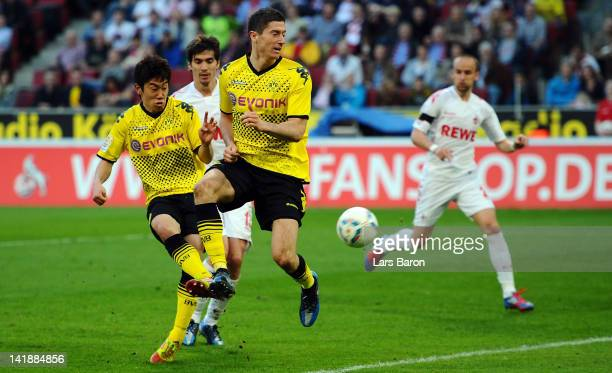 Shinji Kagawa of Dormtund scores his teams fives goal during the Bundesliga match between 1 FC Koeln and Borussia Dortmund at RheinEnergieStadion on...
