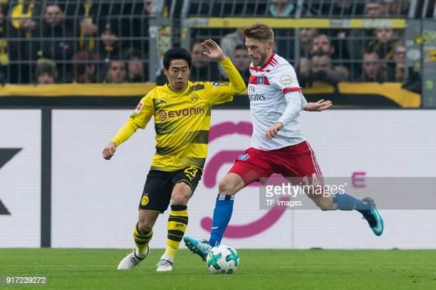 Shinji Kagawa of Dortmund and Aaron Hunt of Hamburg battle for the ball during the Bundesliga match between Borussia Dortmund and Hamburger SV at...