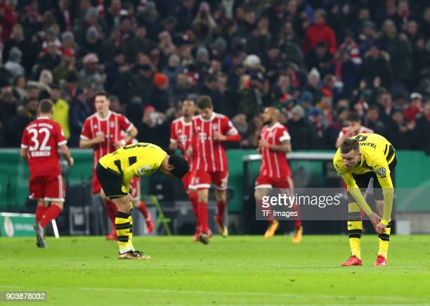 Shinji Kagawa of Dortmund and Andrey Yarmolenko of Dortmund look dejected during the DFB Cup match between Bayern Muenchen and Borussia Dortmund at...