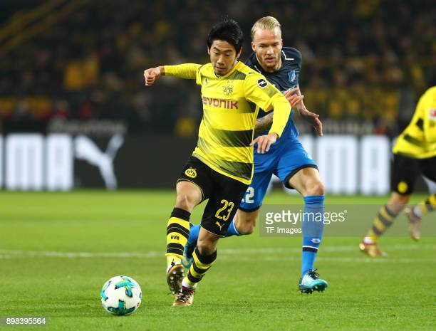 Shinji Kagawa of Dortmund and Kevin Vogt of Hoffenheim battle for the ball during the Bundesliga match between Borussia Dortmund and TSG 1899...