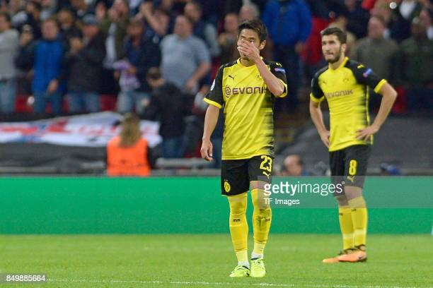 Shinji Kagawa of Dortmund and Nuri Sahin of Dortmund looks dejected during the UEFA Champions League group H match between Tottenham Hotspur and...