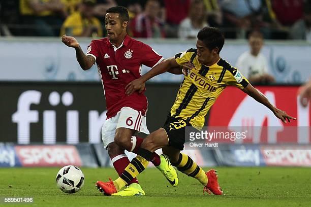 Shinji Kagawa of Dortmund and Thiago Alcantara of Munich compete for the ball during DFL Supercup 2016 match between Borussia Dortmund and FC Bayern...