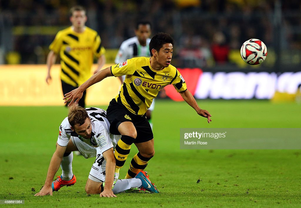 Shinji Kagawa (R) of Dortmund and Tony Jantschke of Gladbach battles for the ball during the Bundesliga match between Borussia Dortmund and Borussia moenchengladbach at Signal Iduna Park on November 9, 2014 in Dortmund, Germany.