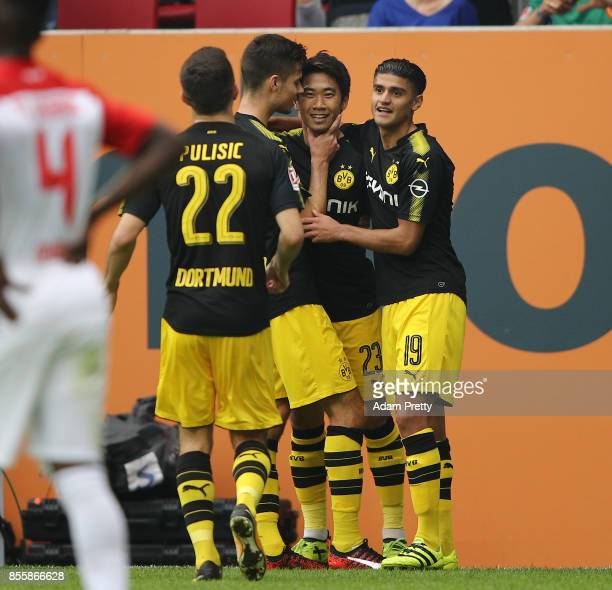 Shinji Kagawa of Dortmund celebrates after he scored his teams second goal to make it 21 during the Bundesliga match between FC Augsburg and Borussia...