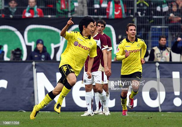 Shinji Kagawa of Dortmund celebrates after he scores his team's opening goal during the Bundesliga match between Hannover 96 and Borussia Dortmund at...