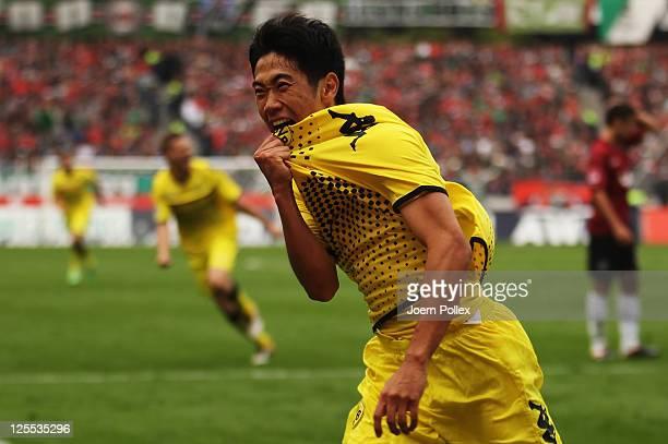 Shinji Kagawa of Dortmund celebrates after scoring his team's first goal during the Bundesliga match between Hanover 96 and Borussia Dortmund at AWD...
