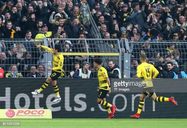Shinji Kagawa of Dortmund celebrates after scoring his team`s first goal with Jadon Malik Sancho of Dortmund and Jeremy Toljan of Dortmund during the...