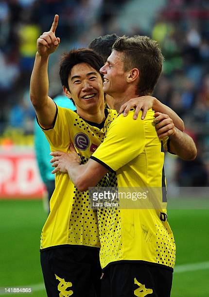 Shinji Kagawa of Dortmund celebrates after scoring his teams fives goal during the Bundesliga match between 1 FC Koeln and Borussia Dortmund at...