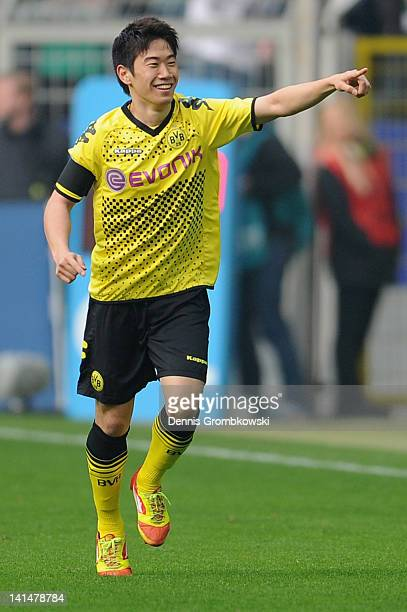 Shinji Kagawa of Dortmund celebrates after scoring his team's opening goal during the Bundesliga match between Borussia Dortmund and SV Werder Bremen...